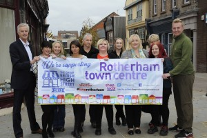 Representatives of RMBC, shopkeepers and the Advertiser with a banner showing support for Rotherhams nomination in The Great British High Street awards